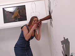 Look how pissed Britney gets when she has to wait until a perv gets into the booth next to hers! But the wait has paid off: when thirteen inches (you read right, 13!) of black meat pop through that hole, Britney`s frown turns upside down! She`s so excited