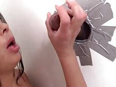 Babe deeply swallows stranger`s brown dong through glory hole.