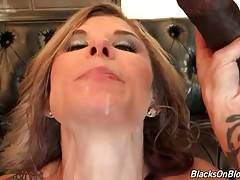 Stunning Chloe Chaos is fed with cum by two black guys.